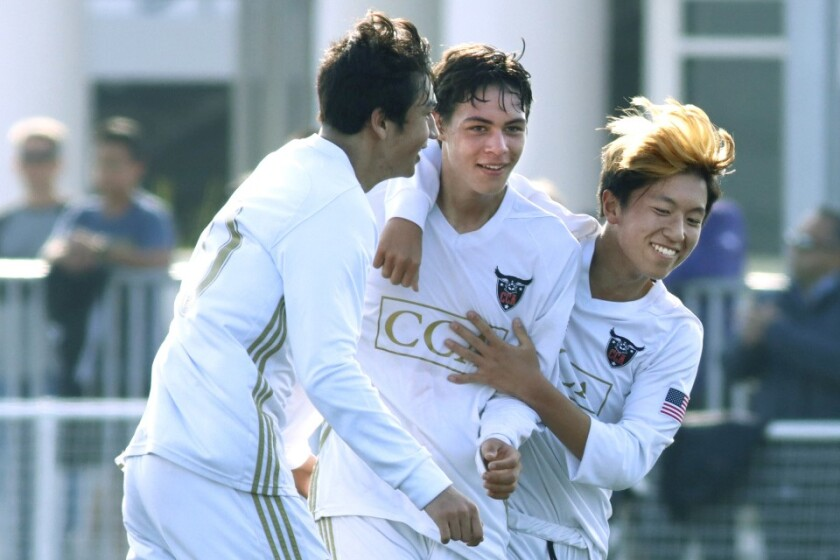 Canyon Crest's Jesse Yu (center) savors his goal with teammates Ben Anderson (left) and Ethan Chang.