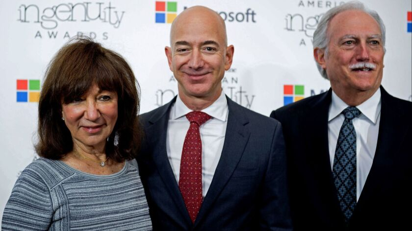 Jackie Bezos, left, and Mike Bezos, right, invested in Amazon in 1995. Their stake could be worth almost $30 billion today.