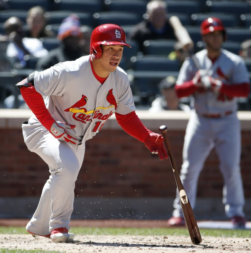 St. Louis Cardinals' Kolten Wong watches his fifth-inning single off New York Mets starting pitcher Bartolo Colon in a baseball game against the New York Mets in New York, Thursday, April 24, 2014. Wong later scored on a Tony Cruz double to left field. (AP Photo/Kathy Willens)
