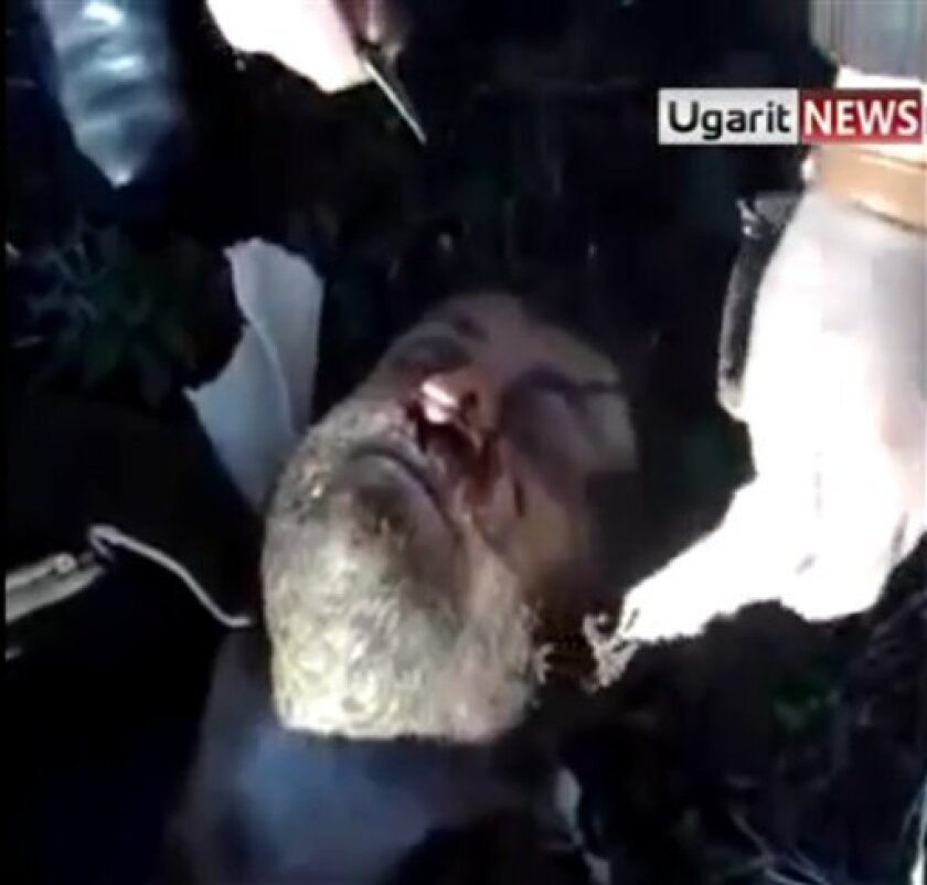 This image from amateur video made available by the Ugarit News group on Monday, Jan. 2, 2012, purports to show a body that had been blindfolded in Idlib, Syria.(AP Photo/Ugarit News Group via APTN) THE ASSOCIATED PRESS CANNOT INDEPENDENTLY VERIFY THE CONTENT, DATE, LOCATION OR AUTHENTICITY OF THIS MATERIAL. TV OUT