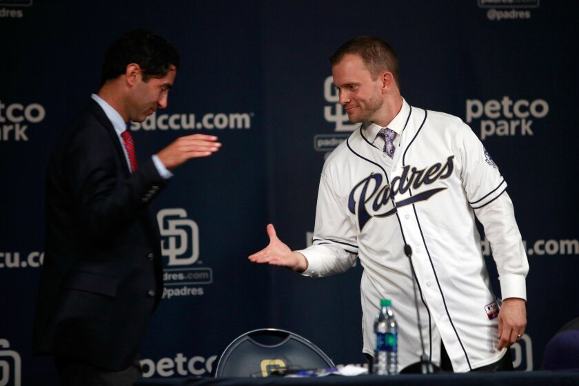 Padres excutive vice president/ general manager A.J. Preller introduces the new Padres manager Andy Green Thursday.