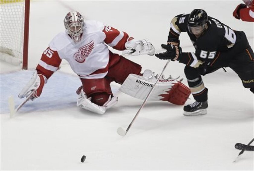Detroit Red Wings goalie Jimmy Howard, left, blocks a shot from Anaheim Ducks right wing Emerson Etem during the second period in Game 1 of their first-round NHL hockey Stanley Cup playoff series in Anaheim, Calif., Tuesday, April 30, 2013. (AP Photo/Chris Carlson)
