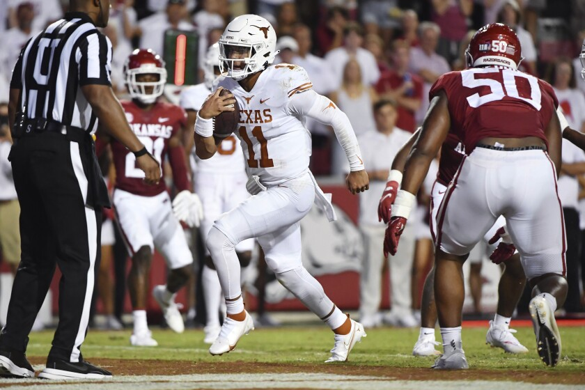 Texas quarterback Casey Thompson (11) runs for a touchdown against Arkansas during the second half of an NCAA college football game Saturday, Sept. 11, 2021, in Fayetteville, Ark. (AP Photo/Michael Woods)