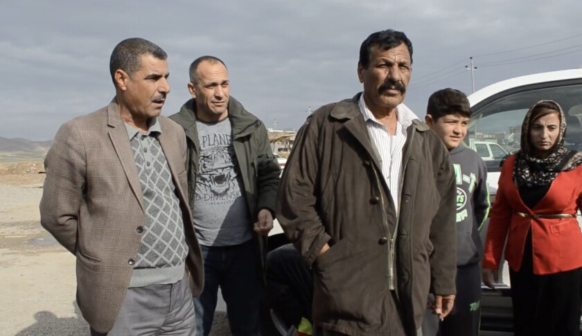 Khaleel Aldakhi, second from left, watches as a 10-year-old boy he delivered being reunited with hi
