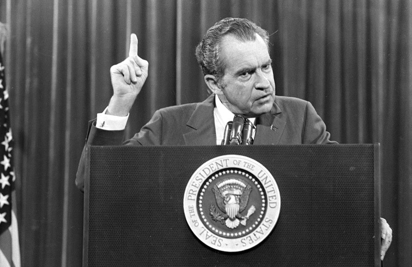 """FILE - In this Nov. 17, 1973 file photo, President Richard Nixon speaks near Orlando, Fla. to the Associated Press Managing Editors annual meeting. Nixon told the APME """"I am not a crook."""" There were two men in 1980s Manhattan who craved validation — one a past president, one a future president. That's how a thirty-something Donald Trump and a seventy-ish Richard Nixon struck up a decade-long correspondence in the 1980s that meandered from football and real estate to Vietnam and media strategy. Their letters are being revealed for the first time in an exhibit that opens Thursday at the Richard Nixon Presidential Library & Museum. (AP Photo)"""