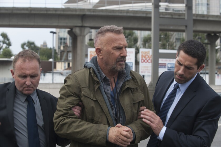 """Kevin Costner, center, as Jericho Stewart, flanked by CIA agents in the movie """"Criminal."""""""