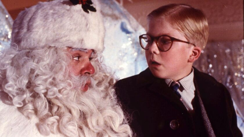 """Ralphie Parker (Peter Billingsley, right) chats up a department-store Santa (Jeff Gillen) in the holiday classic """"A Christmas Story"""" airing on TBS and TNT."""