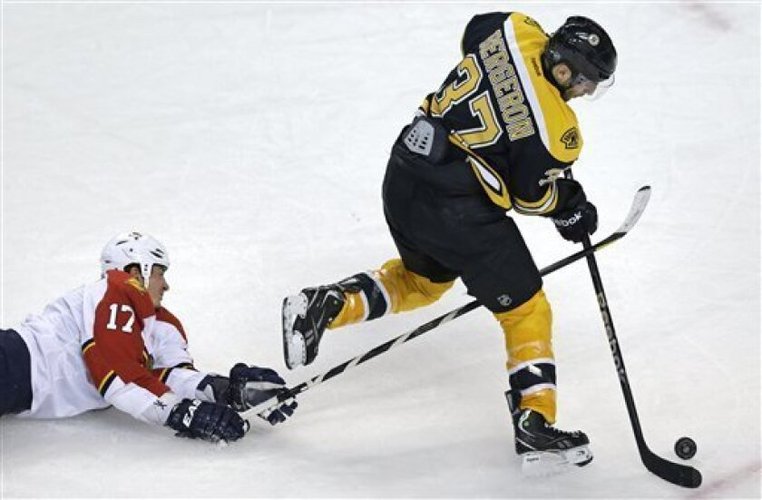Boston Bruins center Patrice Bergeron (37) out skates Florida Panthers defenseman Filip Kuba (17) on his way to an empty-net goal during the third period of an NHL hockey game in Boston, Thursday, March 14, 2013. The Bruins won 4-1. (AP Photo/Charles Krupa)