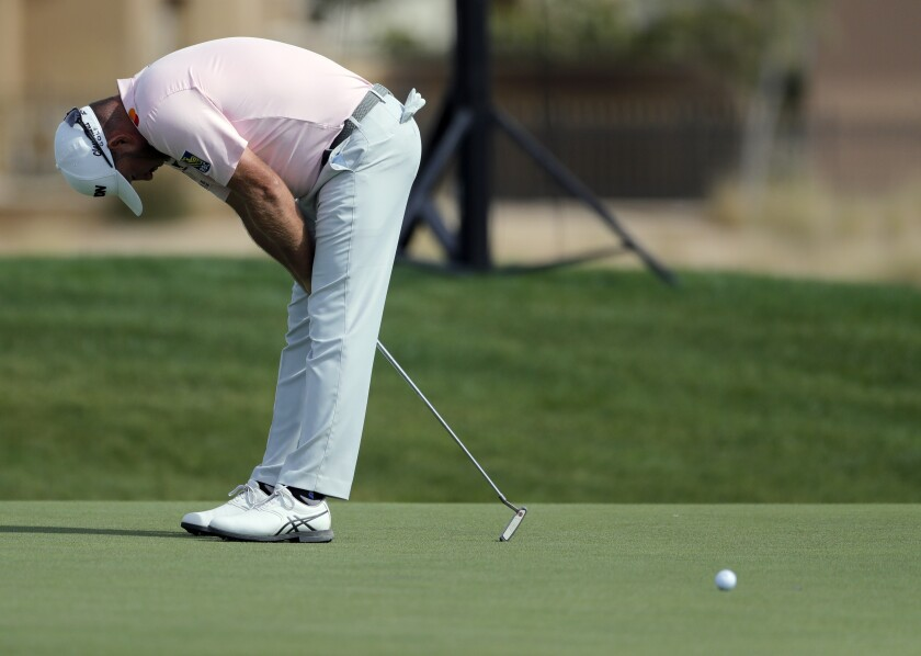 Graeme McDowell from Northern Ireland reacts after he missed the 5th hole during the third round of the Saudi International at Royal Greens Golf and Country Club, Saturday, Feb. 1, 2020, in Red Sea resort of King Abdullah Economic City, Saudi Arabia. (AP Photo/Amr Nabil)