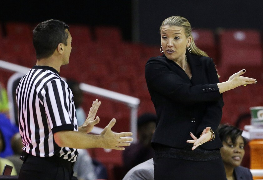 FILE - In this Monday, Dec. 9, 2013, file photo, Siena head coach Ali Jaques, right, speaks with an official in the second half of an NCAA college basketball game against Maryland in College Park, Md. Siena will play for the first time in nearly a month on Wednesday, Feb. 3, 2021, at Monmouth, with just six available players. (AP Photo/Patrick Semansky, File)