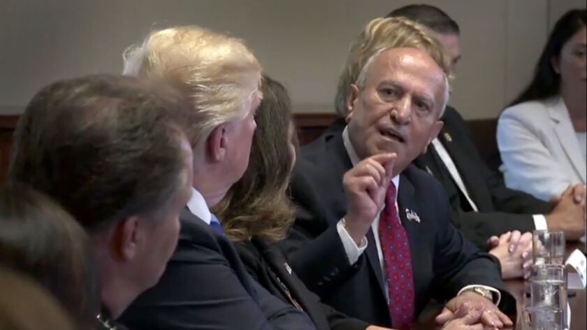 Escondido Mayor Sam Abed addresses President Trump during a roundtable on immigration policy in California earlier this year. Abed enjoys a healthy lead in campaign financing in his bid to win a third term as Mayor.