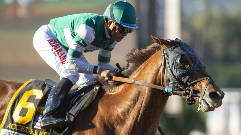 In a photo provided by Benoit Photo, Accelerate and jockey Joel Rosario win the Grade I, $300,000 Aw