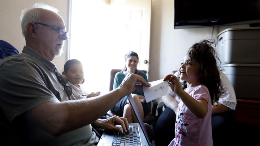 PACOIMA, CA OCTOBER 16, 2018: Los Angeles Times Columnist Steve Lopez, left, interviews a family i
