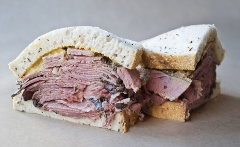 An overstuffed pastrami sandwich awaits you at Lucky's Lunch Counter. Do your mouth stretches now.