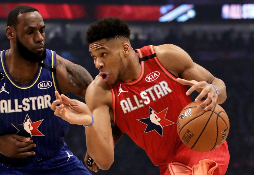 Milwaukee Bucks star Giannis Antetokounmpo tries to drive past Lakers star LeBron James during the NBA All-Star game on Sunday.
