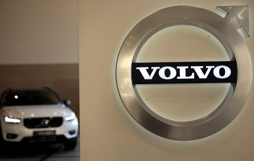 Volvo car and Volvo logo