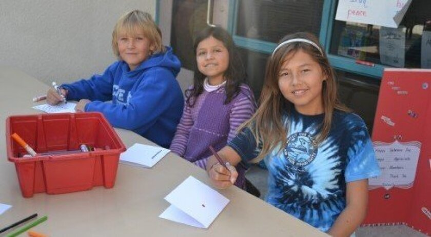 Aidan Davis, Amaya Mirsky and Nicole Foley make cards for veterans. (Photo: Stacy Phillips)