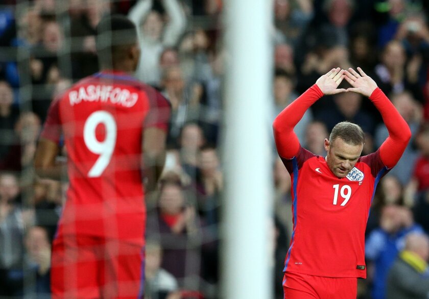 England's Wayne Rooney, right, celebrates his goal during the international friendly soccer match between England and Australia at the Stadium of Light, Sunderland, England, Friday, May 27, 2016. (AP Photo/Scott Heppell)