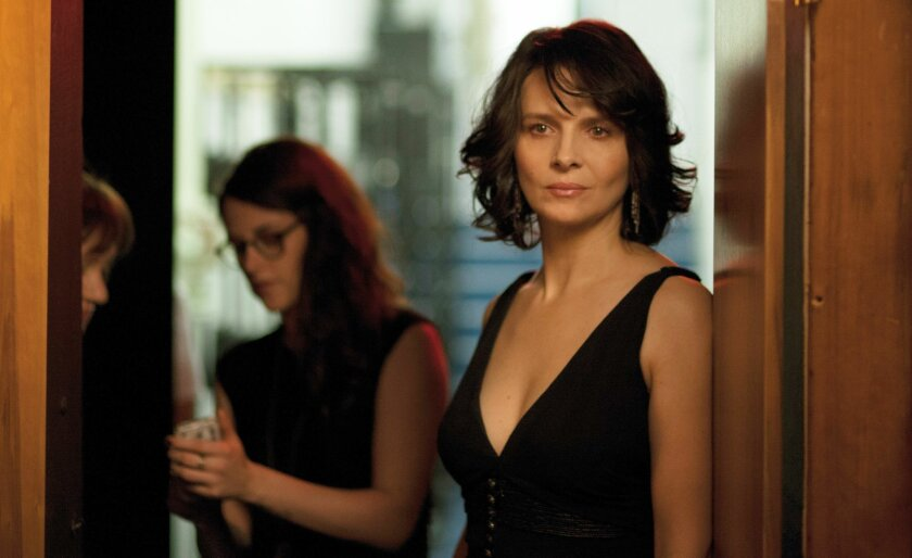 """This image released by IFC Films shows Kristen Stewart, left, and Juliette Binoche in a scene from """"Clouds of Sils Maria."""" (AP Photo/IFC Films)"""