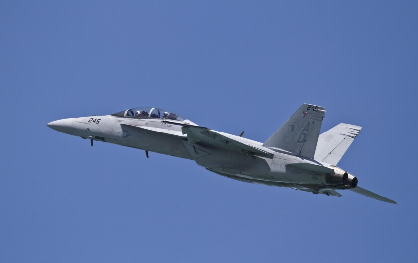 A U.S. Navy F-18 fighter jet flies over North Beach on the opening day of the Chicago Air and Water Show on Saturday, Aug. 18, 2012 in Chicago.