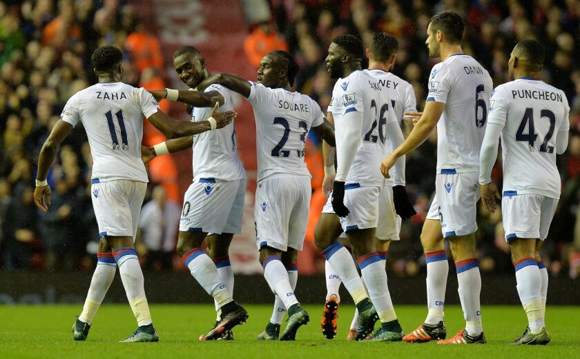 Crystal Palace's Yannick Bolasie, second left, celebrates scoring against Liverpool during the English Premier League soccer match at Anfield, Liverpool, England, Sunday Nov. 8, 2015. (Martin Rickett/PA via AP) UNITED KINGDOM OUT