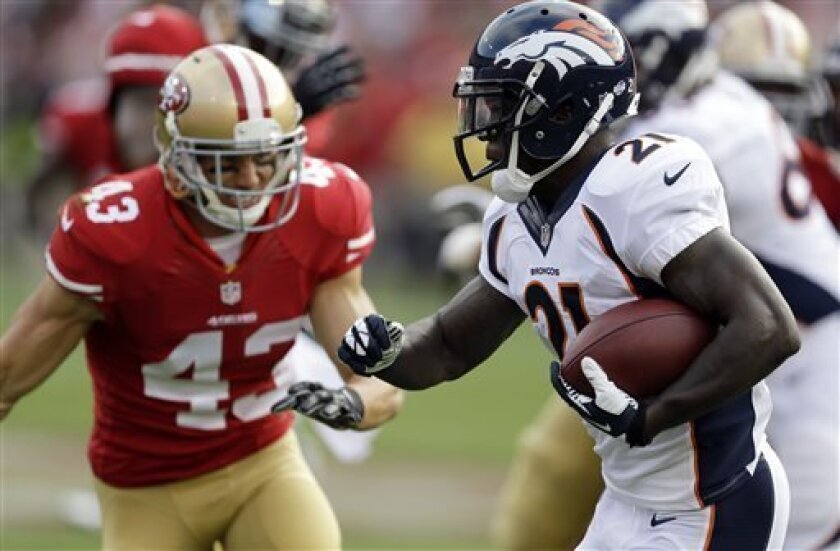 Denver Broncos running back Ronnie Hillman, right, carries the ball as San Francisco 49ers strong safety Craig Dahl, left, pursues during the first quarter of an NFL preseason football game on Thursday, Aug. 8, 2013, in San Francisco. (AP Photo/Ben Margot)