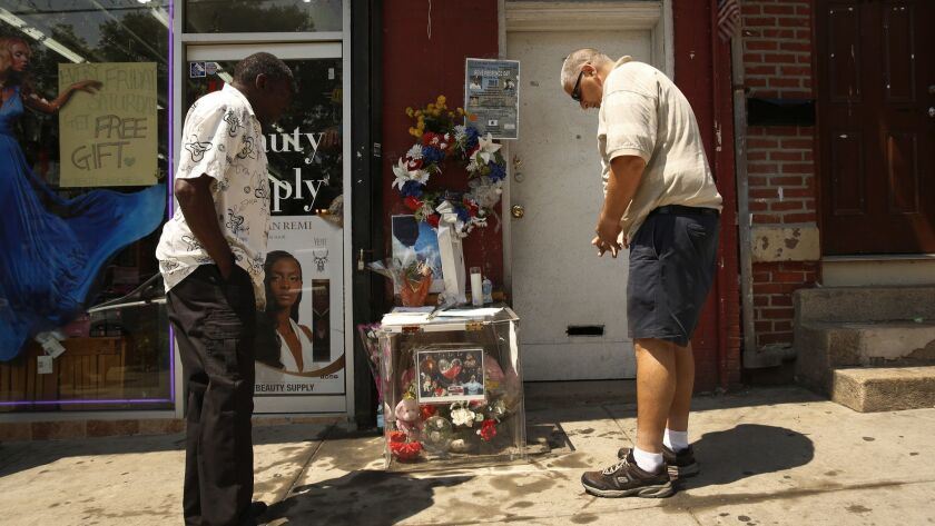Mourners stop to pray at the memorial site for Eric Garner in Staten Island on July 17, 2015, on the anniversary of his death.