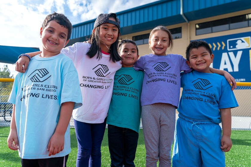 Children stand in front of the Boys & Girls Club in Escondido.