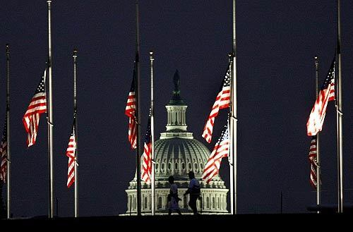 Flags fly at half-staff Tuesday at the U.S. Capitol to mark the sixth anniversary of the Sept. 11, 2001, attacks. In New York, families of the victims mourned inside the pit where the two towers crumbled and a park near ground zero served as the memorial site. At the Pentagon, officials held a service near the section of the building, now rebuilt, into which United Flight 77 crashed at 9:39 a.m, while at 9:55 a.m. in Shanksville, Pa., a memorial began at the field where United Flight 93 crashed after passengers stormed the cockpit of the hijacked plane.