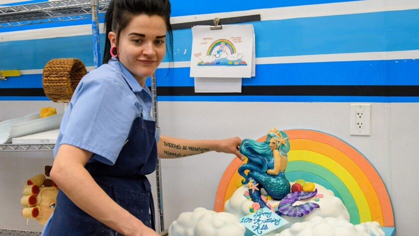 Cake Decorator Brittnee Klinger and the Mermaid cake with drawing, as seen on Vegas Cakes, season 2.