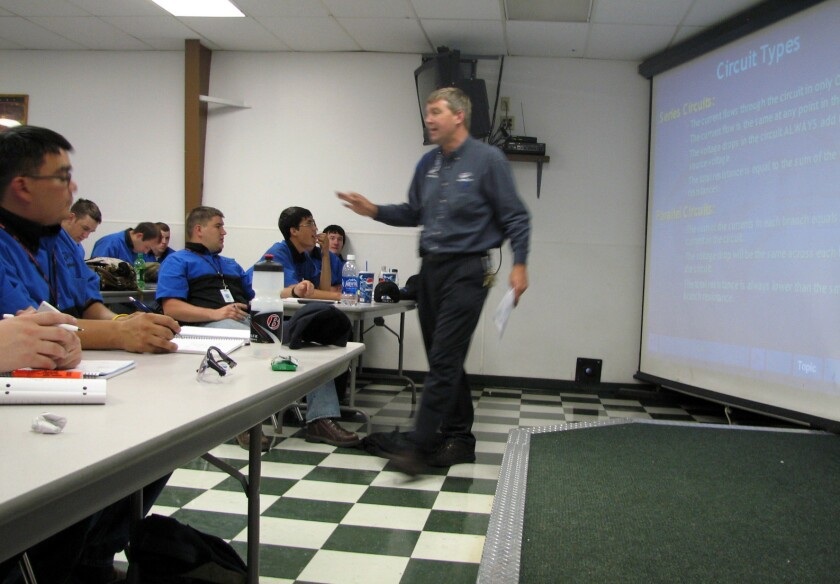 In this June 2009 file photo, Larry Wostenberg teaches an engine management systems class at the WyoTech technical school campus in Laramie, Wyo. WyoTech's parent company, Orange County-based Corinthian Colleges, on Thursday said it's in danger of shutting down.