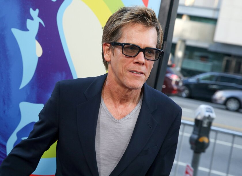 """FILE - In this June 2, 2015, file photo, Kevin Bacon arrives at the LA Premiere Of """"Love & Mercy"""" in Beverly Hills, Calif. Bacon will star in a stage adaptation of the story that inspired Alfred Hitchcock's 1954 classic film """"Rear Window."""" Hartford Stage in Connecticut said Tuesday, Aug. 25, 2015, that the movie star will headline the haunting tale of a wheelchair-bound witness to a possible murder. It's been adapted for the stage by Keith Reddin and will run from Oct. 22-Nov. 15. (Photo by Rich Fury/Invision/AP, File)"""