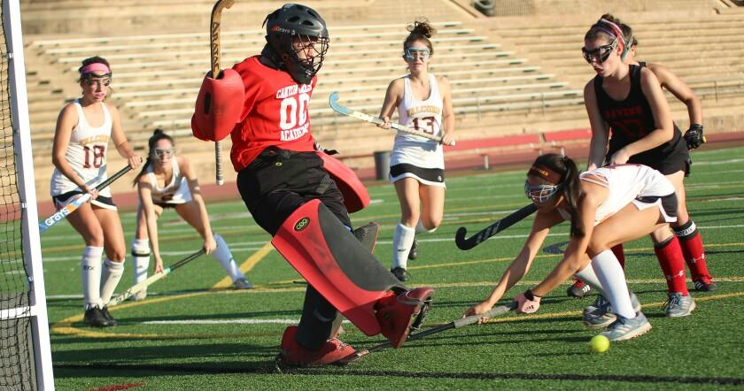 CCA goalie Annie Daruwala makes kick save.
