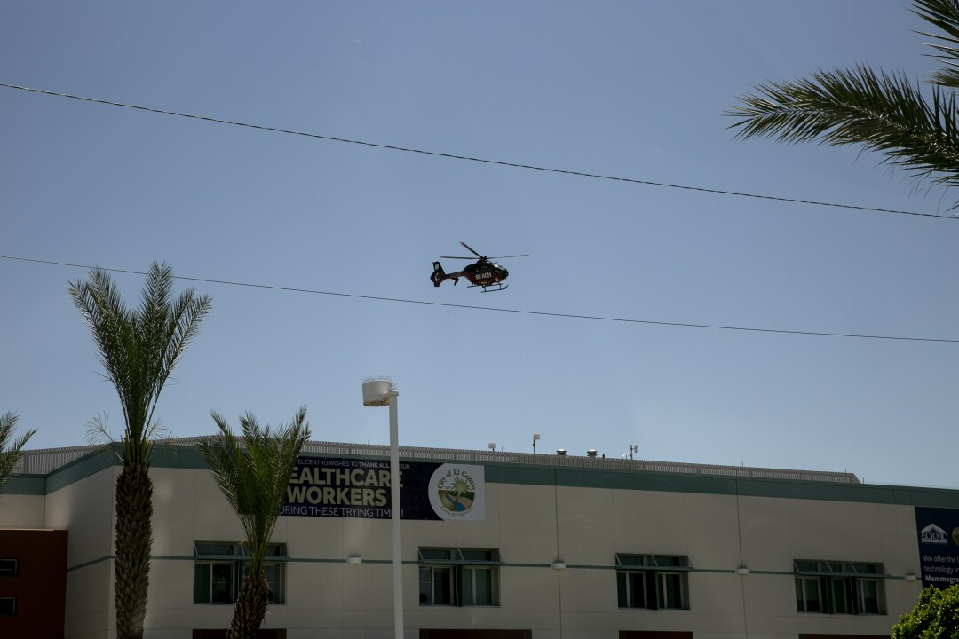 A REACH Air Medical Services helicopter operating under call sign Reach 9, takes off from El Centro Regional Medical Center with a patient aboard an air ambulance bound for a San Diego area hospital on May 20, 2020 in El Centro, California.