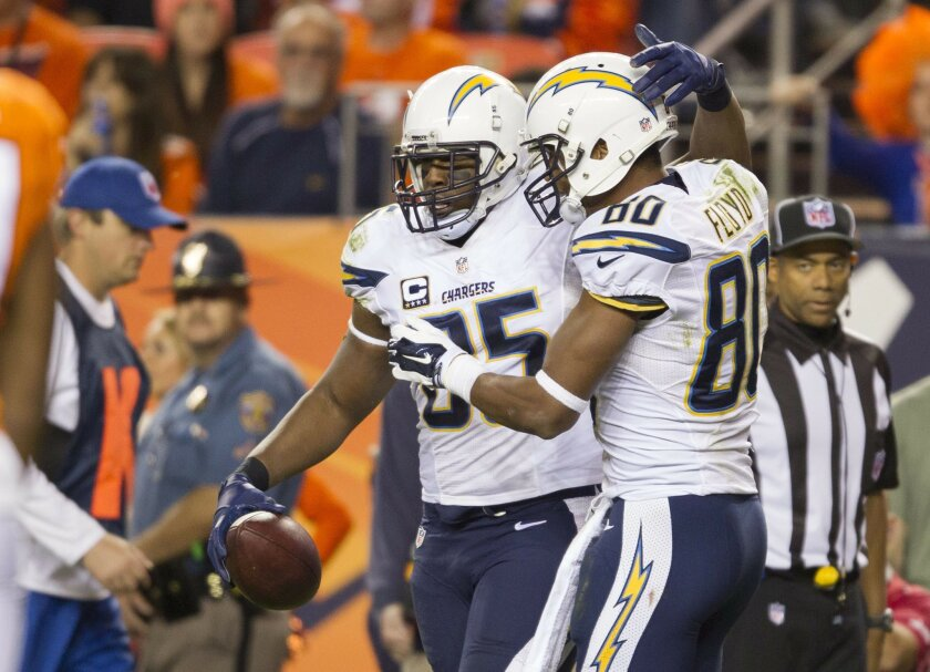Denver Broncos vs. San Diego Chargers at Sports Authority Field.San Diego Chargers tight end Antonio Gates (85) and San Diego Chargers wide receiver Malcom Floyd (80) react to Gates third touchdown of the evening, this one coming in the 4th quarter.