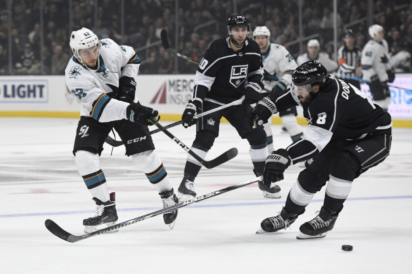 Sharks right wing Kevin Labanc puts a shot on net in front of Kings defenseman Drew Doughty during a game Nov. 25 at Staples Center.