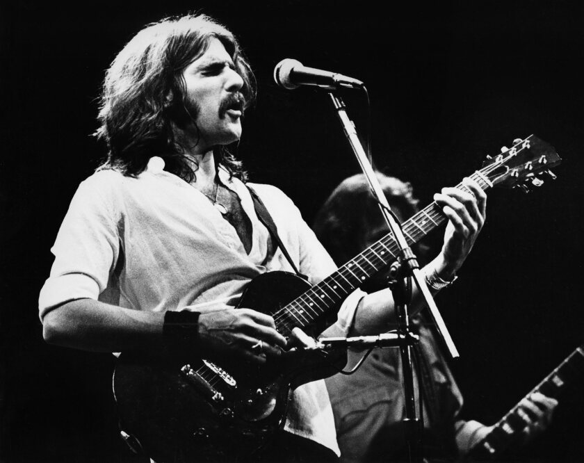 Glenn Frey performs with the Eagles in 1977 in the Netherlands.