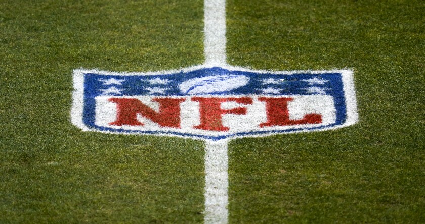 The NFL logo on a football field