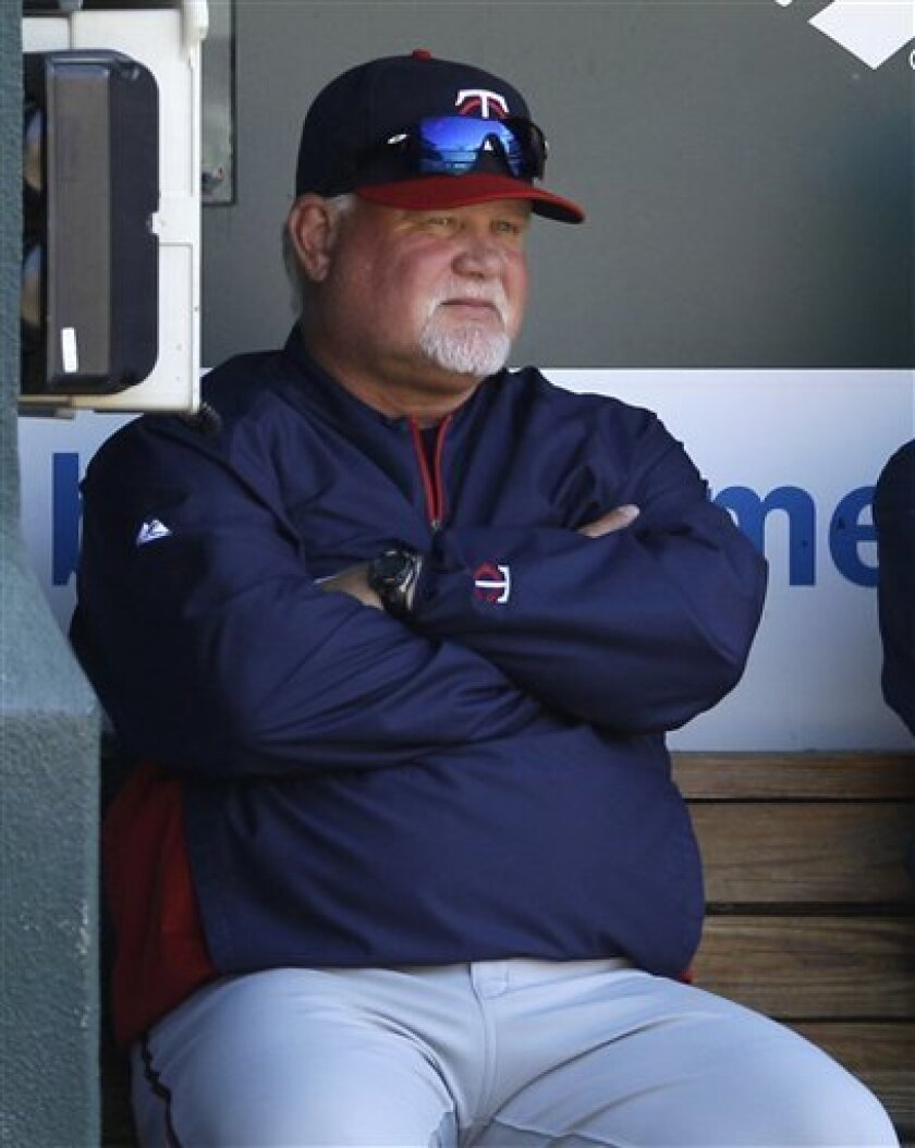 Minnesota Twins manager Ron Gardenhire watches from the dugout during a baseball game against the Baltimore Orioles in Baltimore, Sunday, April 8, 2012. Baltimore won 3-1. (AP Photo/Patrick Semansky)