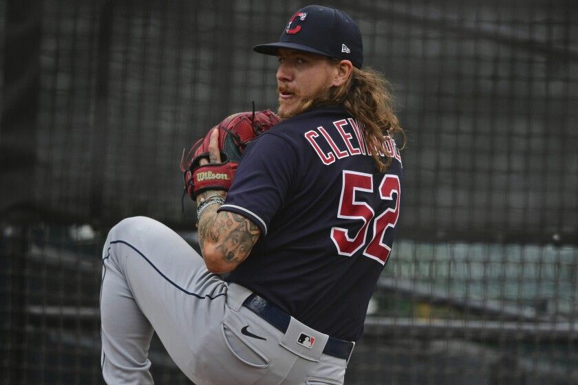Cleveland Indians starting pitcher Mike Clevinger warms up in the bullpen