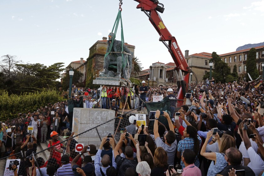 Students at Cape Town University cheer as a statue of British colonialist Cecil Rhodes is taken down in 2015.
