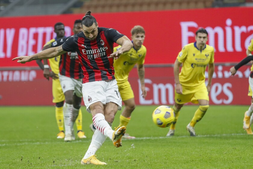 AC Milan's Zlatan Ibrahimovic follows through on a penalty kick against Hellas Verona on Sunday.