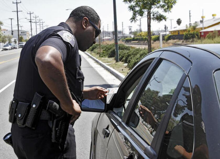 Glendale police officer Aaron Zeigler pulls over a driver who was allegedly using a cellphone while driving on San Fernando Road.