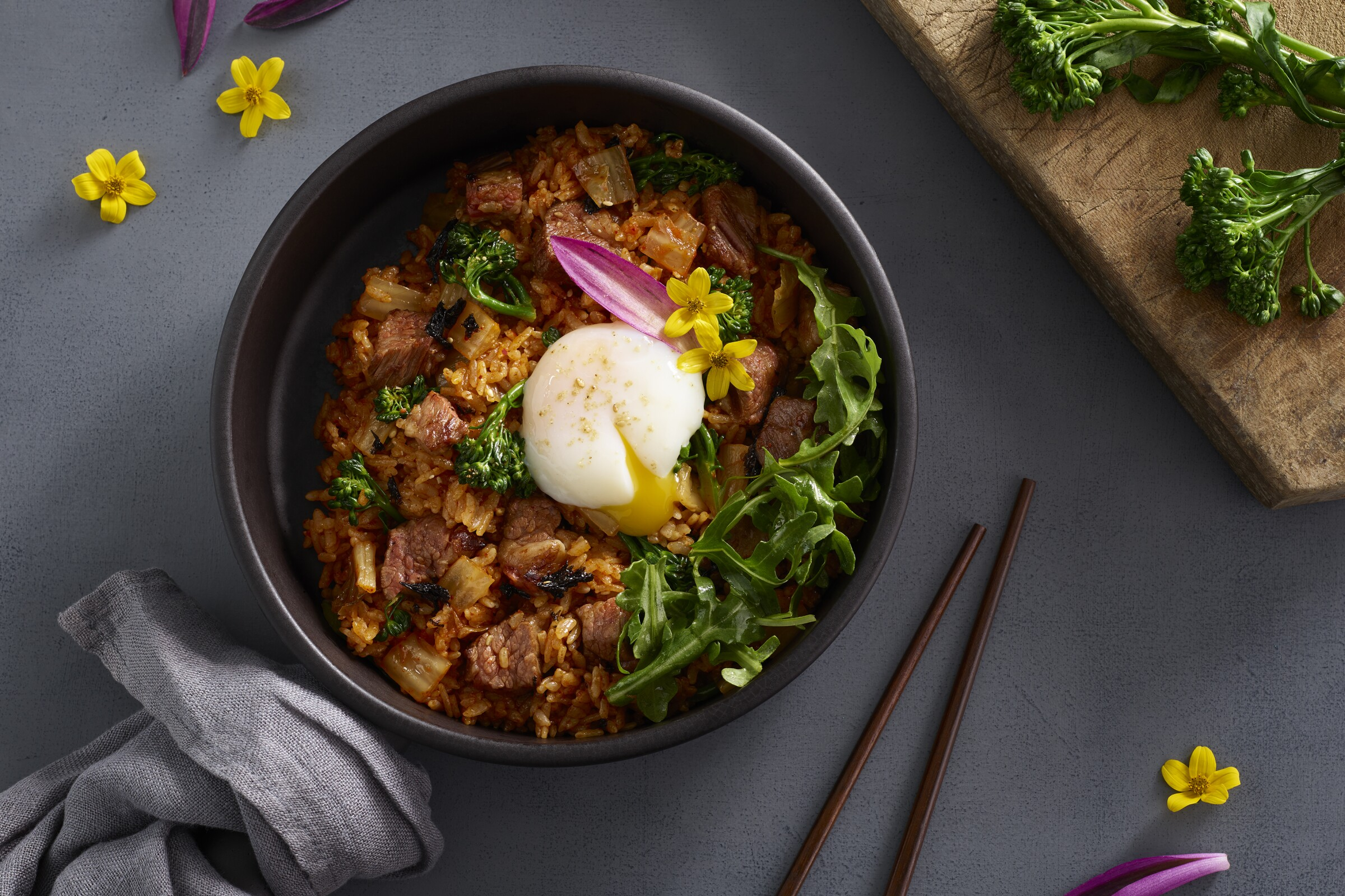 The new Bibigo Kitchen at Fashion Valley puts a modern, elegant twist on casual Korean food, like this steak kimchi fried rice served in a hot stone bowl, with a sous vide egg.