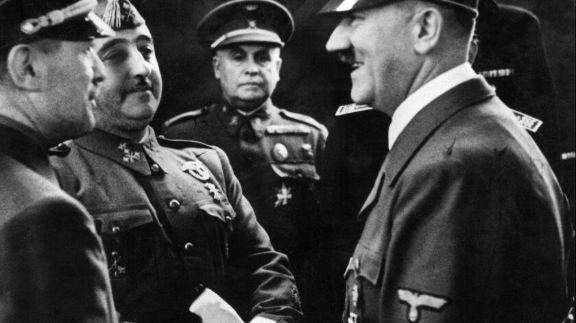 Nazi leader German Chancellor Adolph Hitler (R) sh
