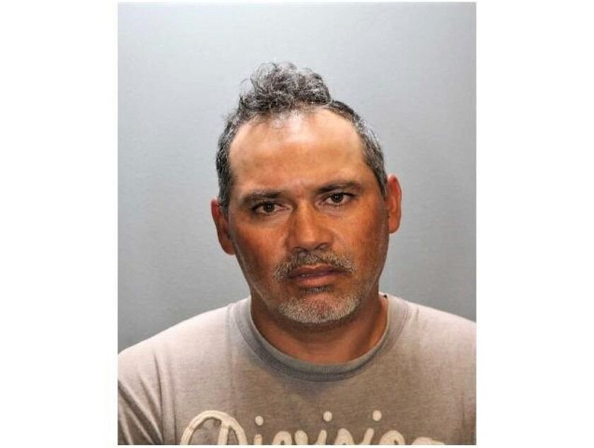 Arturo Silva-Ramos, 45, was arrested Sunday after allegedly pointing a gun at a motorist in Costa Mesa.