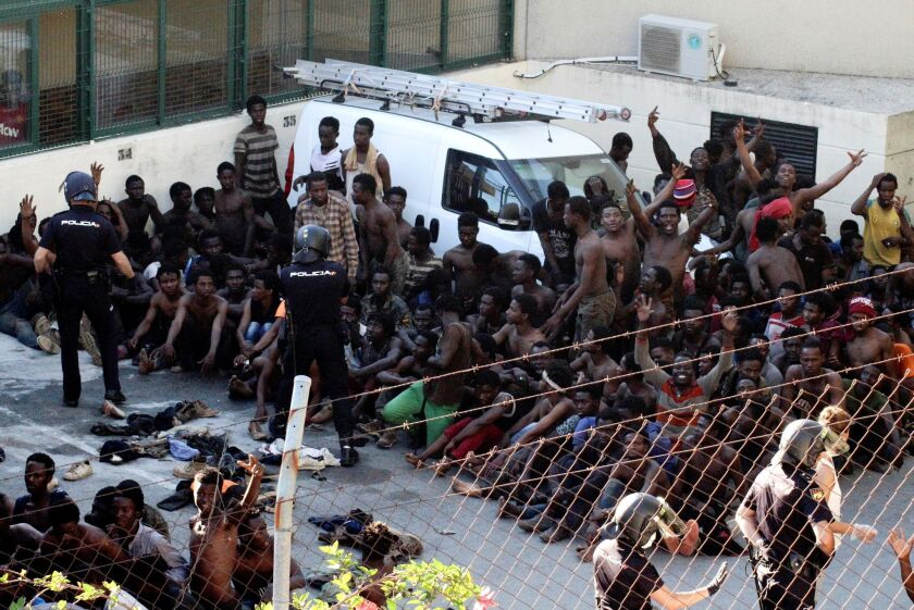 Some 400 migrants manage to jump Spanish border fence in Ceuta, Spain - 26 Jul 2018