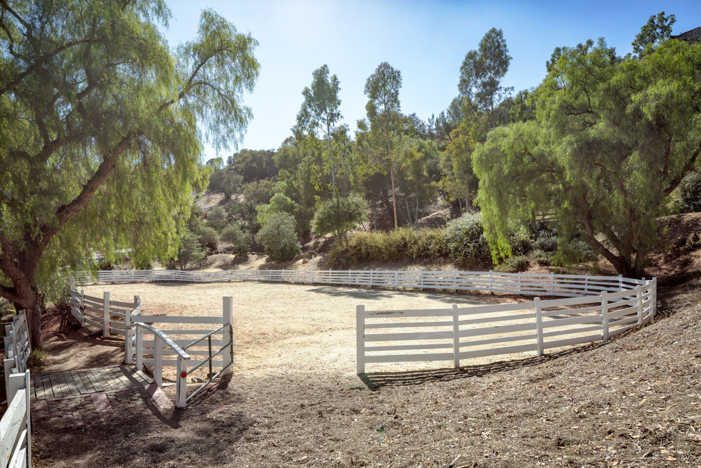 The roughly 30-acre ranch in Topanga features two homes, horse facilities, orchards and organic gardens.