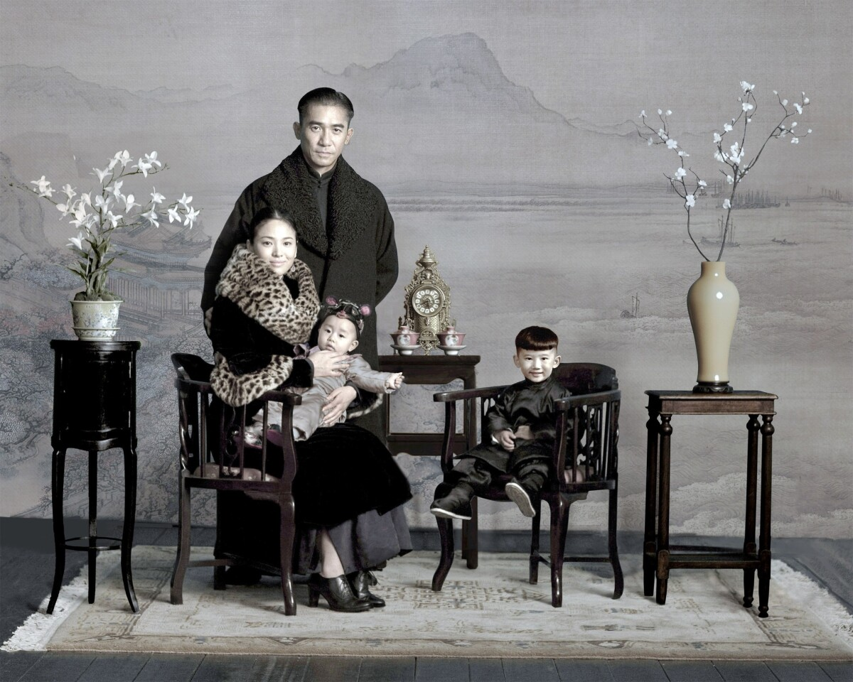 """Hye-Kyo Song and Tony Leung, who stars as Ip Man, in a scene in which a family portrait is taken in """"The Grandmaster,"""" by director Wong Kar Wai. The fur collar on her coat came from a vintage find."""