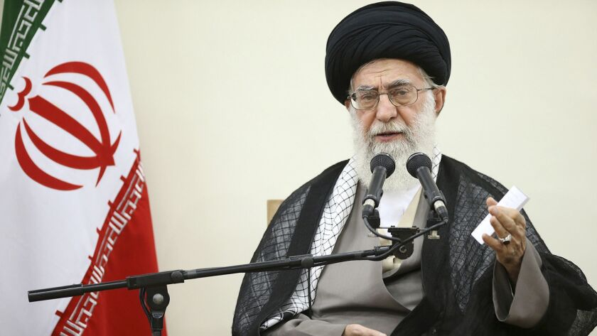 Iranian leader Ayatollah Ali Khamenei speaks with members of Iran's Experts Assembly in Tehran on Sept. 3, 2015.